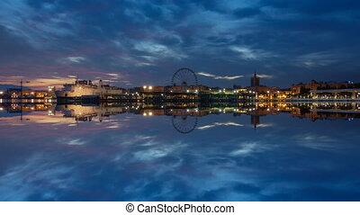Dusk over Malaga city skyline and reflection