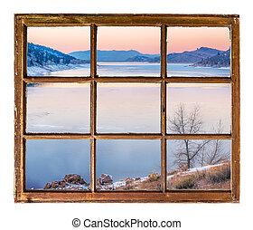 dusk over mountain lake in winter