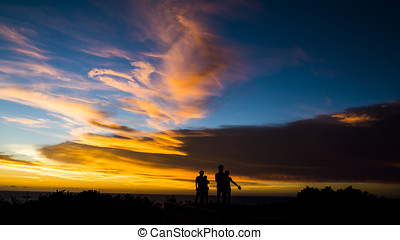 Dusk, people silhouettes
