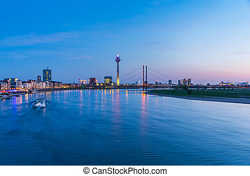 Dusseldorf cityscape at the rhine river on sunset