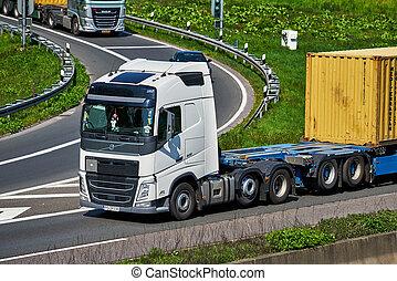 DUSSELDORF ,GERMANY - APRIL 20: transport truck on the highway on April 20,2017 in Dusseldorf, Germany. truck on asphalt road
