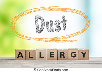 Dust allergy headline on a wooden table with a nature...