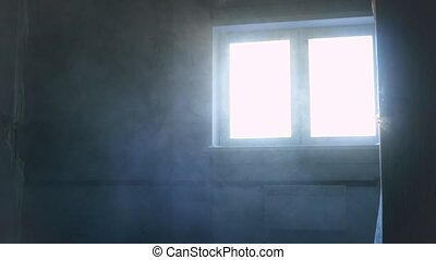 Dust in the room during construction. Blue light from...
