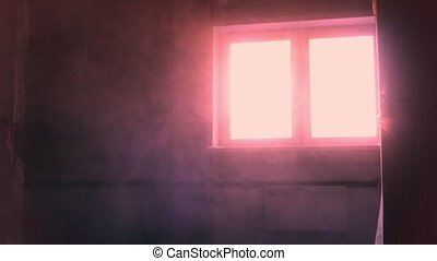 Dust in the room during construction. Red light from window....