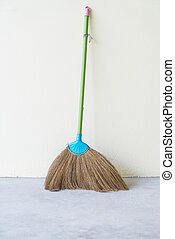 Dust Pan and Broom with wall background