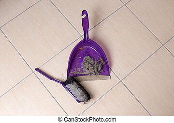 Dust pan with dirt on floor - Top view of dust pan full of...