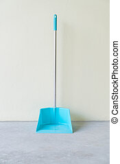 Dust Pan with wall background