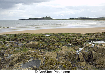 Dustanburgh with rocks and beach