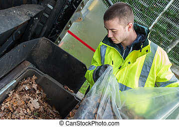 dustman cleans the street
