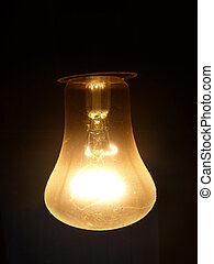 Dusty light bulb on dark background