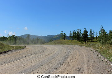 Dusty mountain road in the Republic of Khakassia