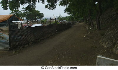Dusty road at Moresby port, Papua New Guinea - Wide still...