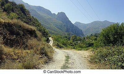 dusty road near skopje in northern macedonia - dusty road to...