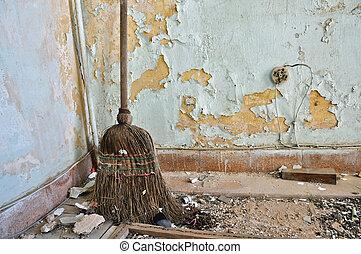 straw broom on filthy floor - Dusty straw broom on filthy...