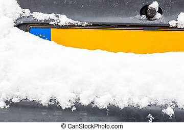 Dutch car license plate with snow