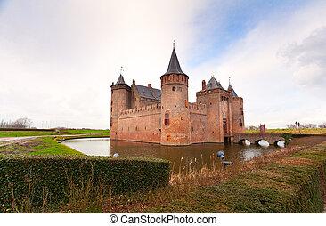 Dutch castle on the lake - castle in Ducth town Muiden in...