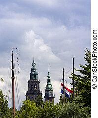 Dutch cityscape with church towers and boat masts - Dutch...