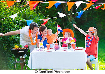 Dutch family having grill party