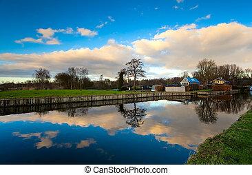 Dutch farm close to lake - Dutch rural view with lake with...