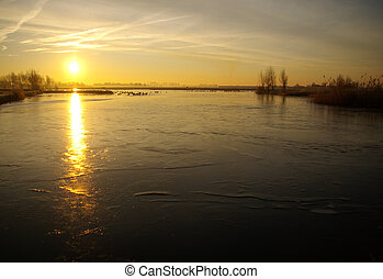 Dutch frozen lake - Frozen lake at sunrise in Holland