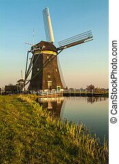 Dutch historic windmill during sunset