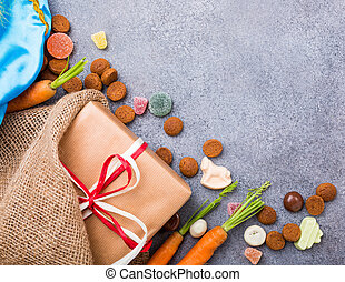 Dutch holiday Sinterklaas background with gift and...