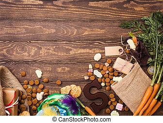 Dutch holiday Sinterklaas background with gifts, pepernoten,...