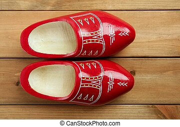 Dutch Holland red wooden shoes on wood