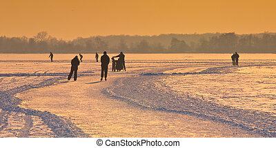 Dutch Ice Skaters under setting sun