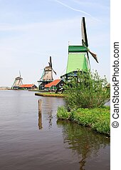 Dutch landscape - Mills along river in Holland