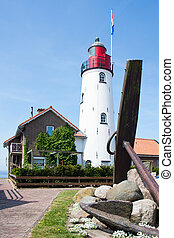 Dutch lighthouse with a big anchor in front of it