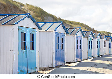 Dutch little houses on beach in De Koog Texel, The Netherlands