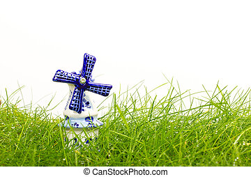 Dutch mini porcelain windmill on wet grass