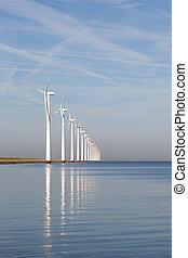 Dutch offshore wind turbines in a calm sea