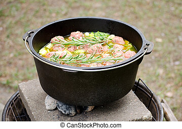 dutch oven with a typical soup dish