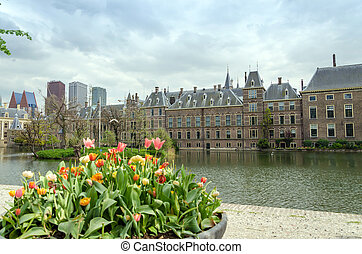 Dutch parliament buildings Binnenhof with skyscrapers in the background in The Hague.