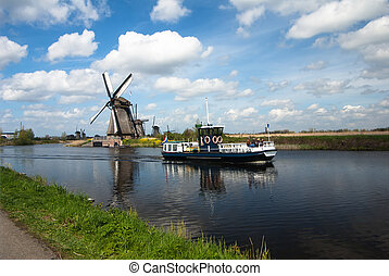traditional dutch landscape with windmills