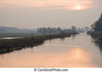 Dutch polderview at winter sunset