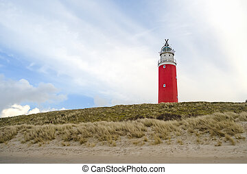 Dutch red lighthouse at the beach