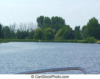 Dutch river shore - Shore of a dutch river, footage taken...