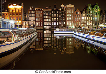 Dutch scenery with its canal side houses and tour boats