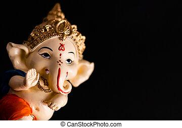 dutch shot of beautiful ganesha on black background. wisdom concept