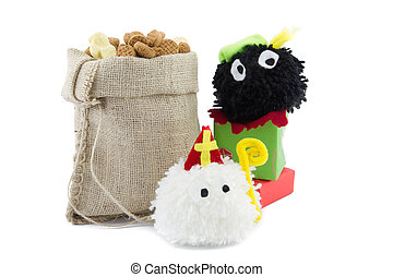 sinterklaas and zwarte piet puppets with burlap sack filled with sweets and presents