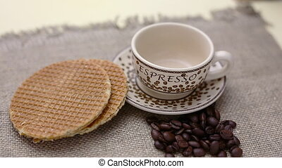 dutch stroopwafel, caramel waffle and coffee on table