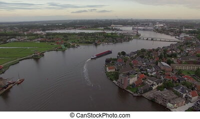 Dutch township on river bank, aerial view