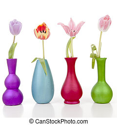 Dutch tulips in colorful vases