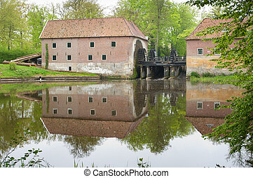 dutch water mill in earlier years used for sawing trees