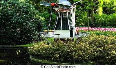 Dutch wind mills - garden with traditional Dutch windmills...