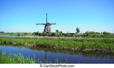 dutch windmill over river waters - panorama traditional...