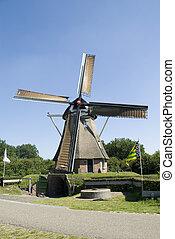 Dutch windmill - Dutch wind-mill in Holland used for corn